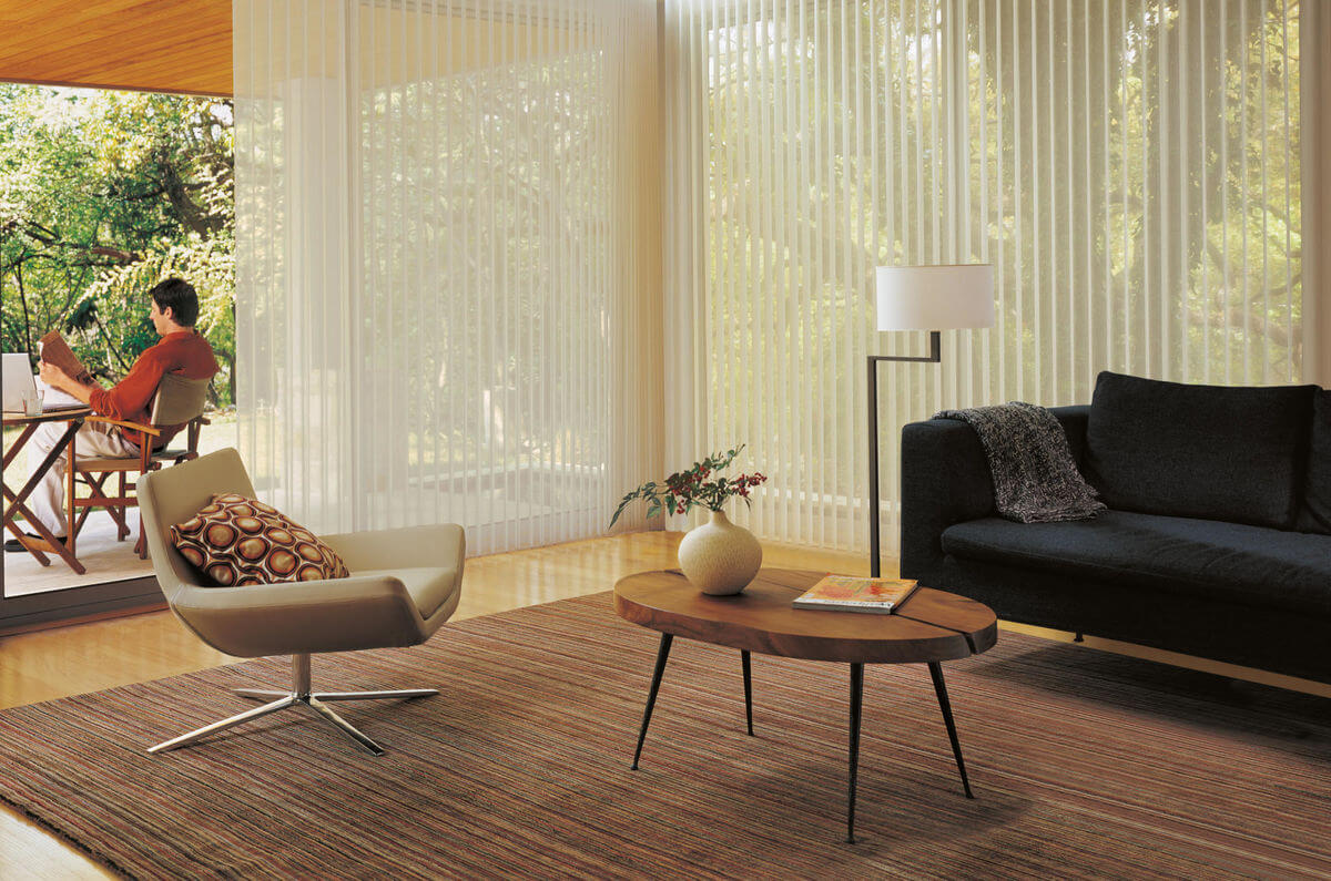 The challenge for adding window treatments to corner windows is the proximity of the windows to each other.